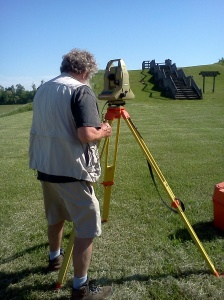 Dr. Bill Monaghan from IU using the Total Station to locate and record points on the site grid on the terrace.